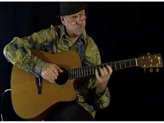 Cours de guitare par un musicien professionnel